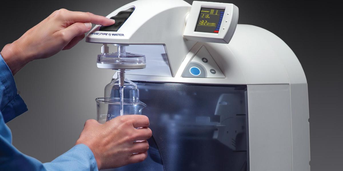 Hands using WaterPro BT laboratory water purification